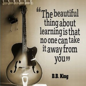 Image showing a photograph of a guitar and a quote from BB King n a website for guitar lessons