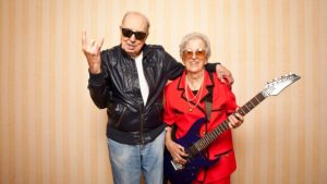Image showing photograph of an old man and woman rocking with a guitar for guitar lessons