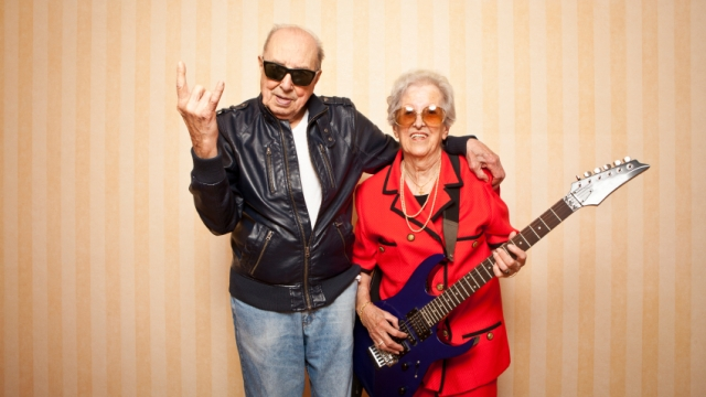 Image showing photograph of an old man and woman rocking with a guitar.