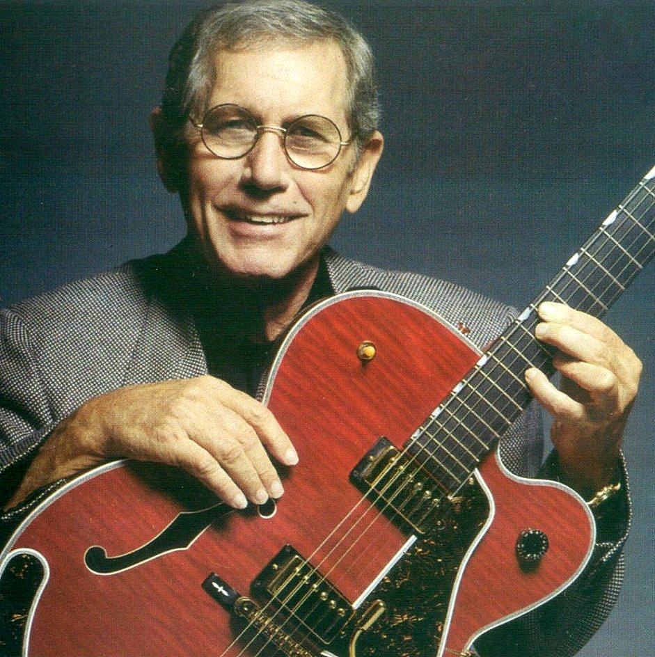 Image showing Chet Atkins holding his trademark Gretsch guitar on a page analysing a Chet Atkins beginner guitar lesson